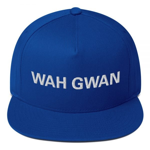 Wah Gwan Flat Bill Cap in royal blue. Jamaican Rasta Patwa Embroidered Cap. The high-profile fit and a green undervisor make this cap a classic with an added pop.