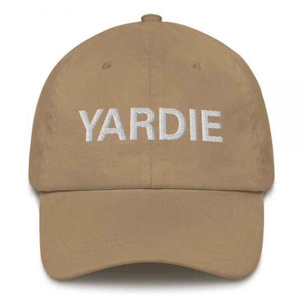 Yardie Dad hat in beige. These Jamaican Patois Rasta caps aren't just for dads. This one's got a low profile with an adjustable strap and curved visor. Quality Rasta Reggae and Jamaican Merchandise available at rastagearshop.com