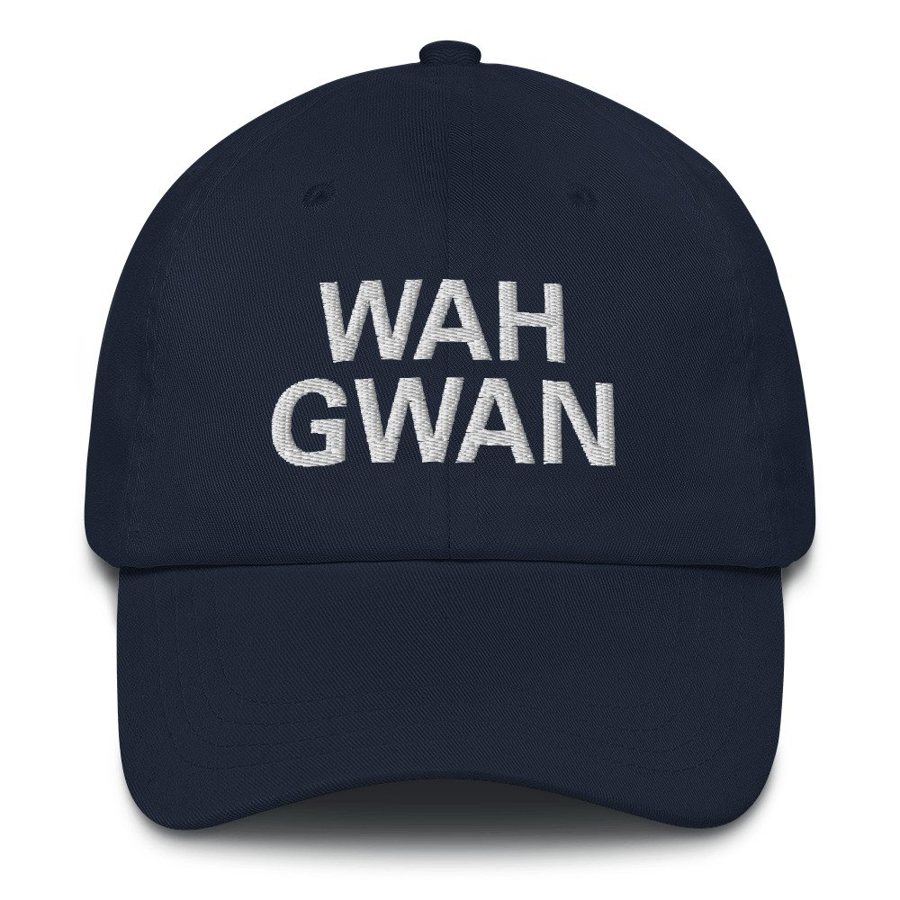 Wah Gwan Dad Hat in navy blue. Jamaican Patois embroidered Jamaican cap. Dad hats aren't just for dads. This one's got a low profile with an adjustable strap and curved visor. Rasta Gear Shop original merchandise and clothing.