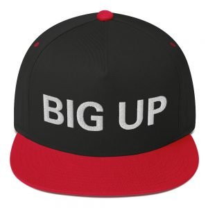 Big Up Flat bill Cap in black and red. The high-profile fit and a green undervisor make this cap a classic with an added pop of color. Rasta Gear Shop Original Rastafarian Jamaican Reggae Merchandise and Clothing