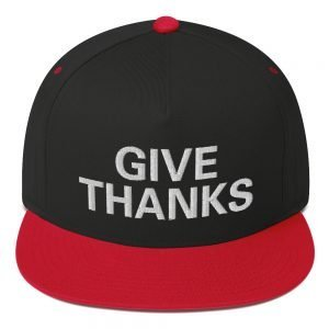 Give Thanks Flat Bill Cap in red and black. Rastafarian, Reggae and Jamaican clothing and merchandise.