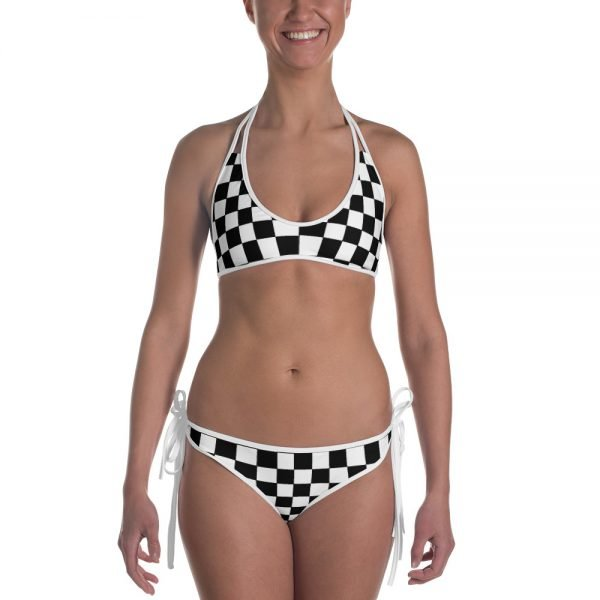 Reggae Ska Bikini in Black and white chequerboard design. Reggae beach party time. Feel the heat with this bright and comfortable swimsuit. The top is similar in style to a sports bra for extra support and a great look while lounging on sandy beaches. Rasta Gear Shop original design.