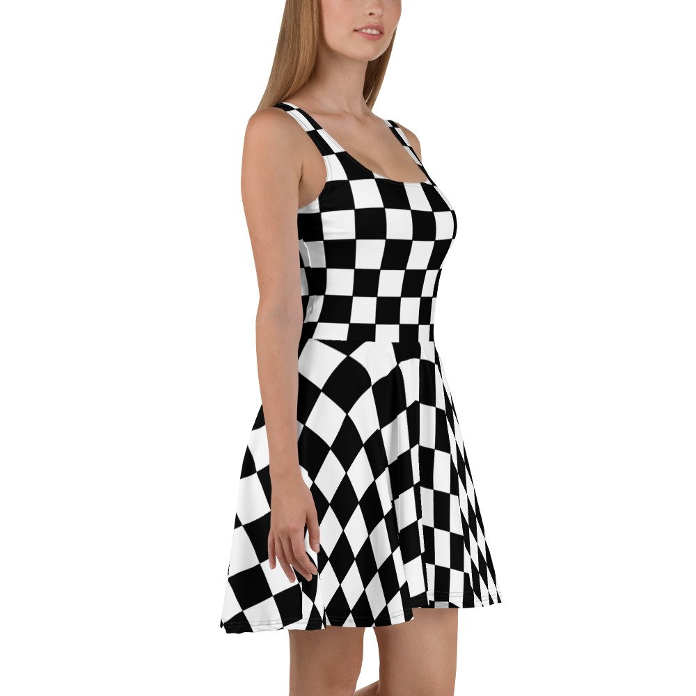 Reggae Ska Skater Dress. Skank the night away in this sleeveless black and white chequerboard skater dress. The soft fabric and flared skirt give it an elegant twist that brings out the intricate design with a beautiful vibrancy. Available at Rastagearshop