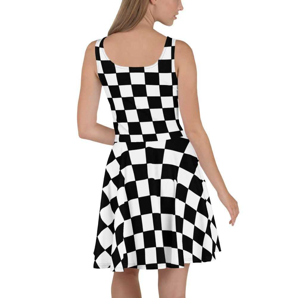 Reggae Ska Skater Dress. Skank the night away in this sleeveless black and white chequerboard skater dress. The soft fabric and flared skirt give it an elegant twist that brings out the intricate design with a beautiful vibrancy.
