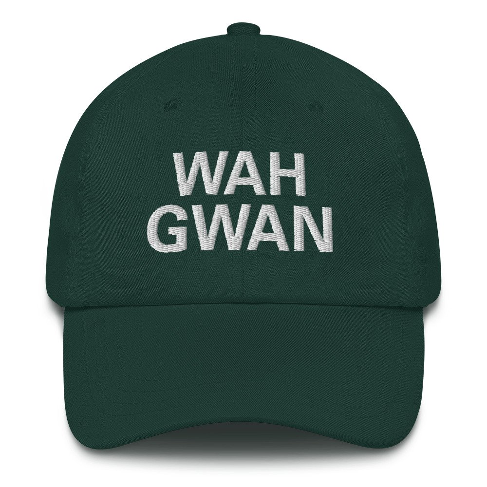 Wah Gwan Dad Hat in Forest Green. Jamaican Patois embroidered Jamaican cap. Dad hats aren't just for dads. This one's got a low profile with an adjustable strap and curved visor. Rasta Gear Shop original merchandise and clothing.