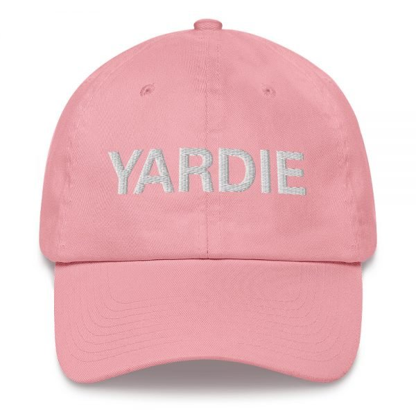 Yardie Dad hat in pink These Jamaican Patois Rasta caps aren't just for dads. This one's got a low profile with an adjustable strap and curved visor. Quality Rasta Reggae and Jamaican Merchandise available at rastagearshop.com