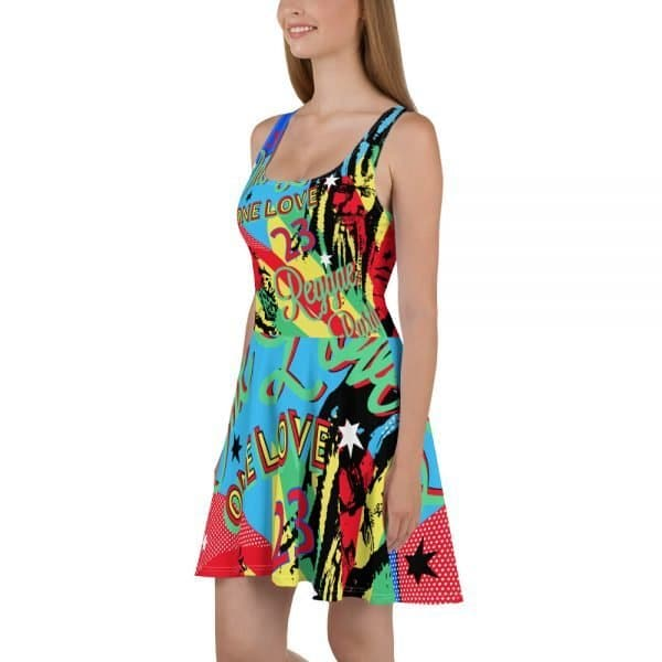 Reggae Party Skater Dress. Jamaican One Love design. Dress to impress with this sleeveless reggae party skater dress! The soft fabric and flared skirt give it an elegant twist that brings out the intricate design with a beautiful vibrancy. Rasta Gear Shop Shop original reggae dress.