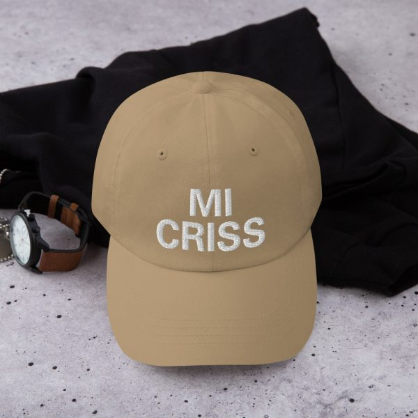 Mi Criss Dad Hat in beige. Jamaican Patois embroidered cap. Dad hats aren't just for dads. This one's got a low profile with an adjustable strap and curved visor. Rasta Gear Shop original Rastafarian, Reggae and Jamaican merchandise, hats, clothing and shoes.