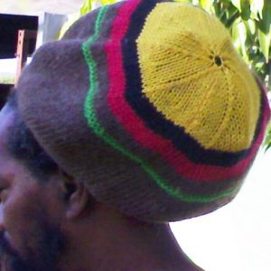 Aboriginal tam handknitted in natural pure Australian merino wool at Rastagearshop. com. Rasta and Aboriginal colors in this deadly tam.