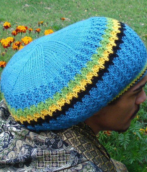 Jamaican tam handknitted in blue pure Australian merino wool with Jamaican color trim. Quality Dreadlock hat from Rastagearshop.com